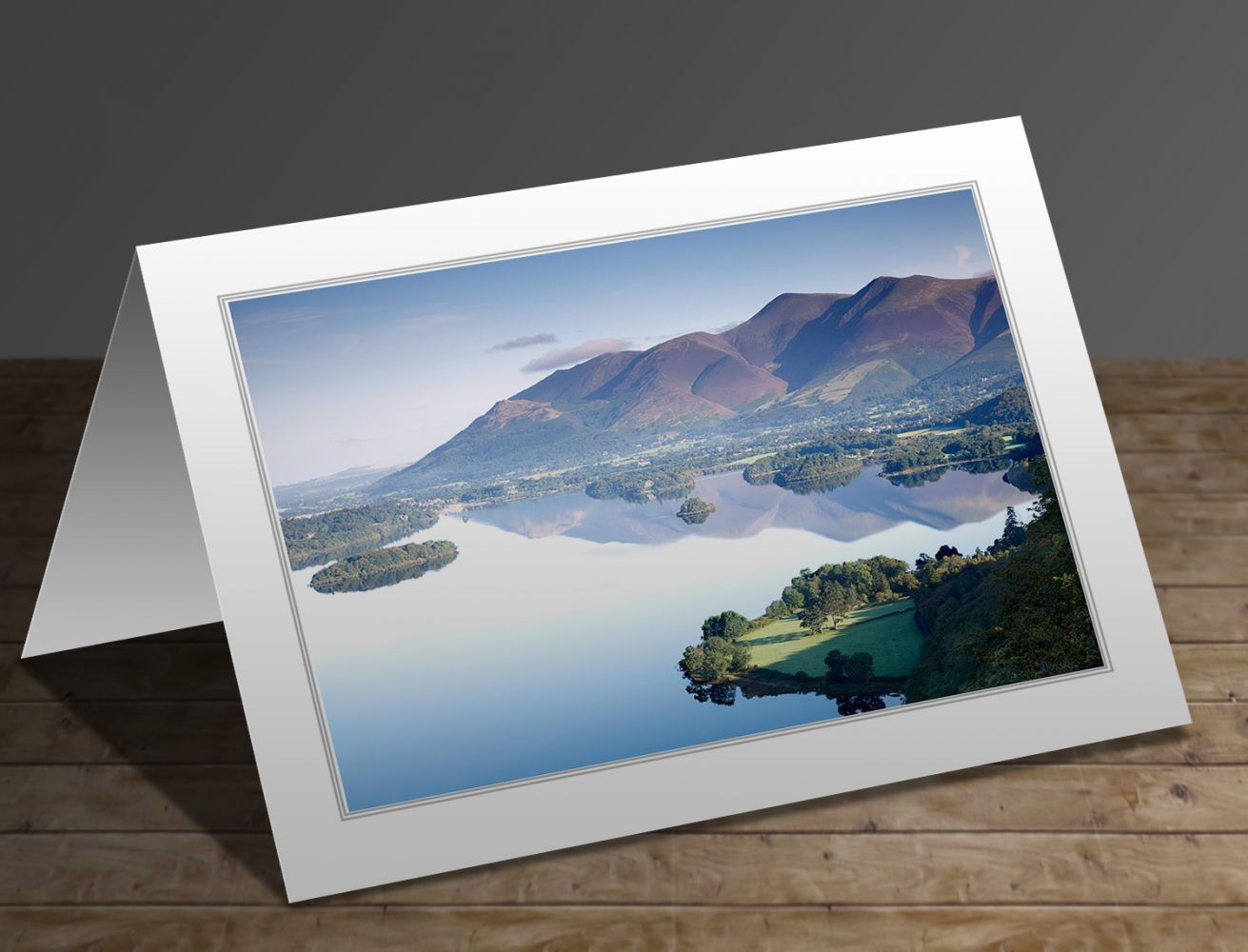A greetings card containing the image Reflections of Skiddaw and Derwentwater from Surprise View - Martin Lawrence