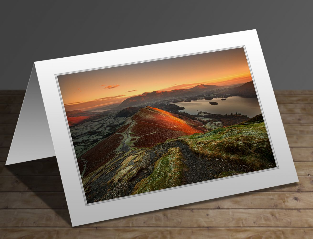 A greetings card containing the image First Light on Catbells and Skiddaw by Martin Lawrence