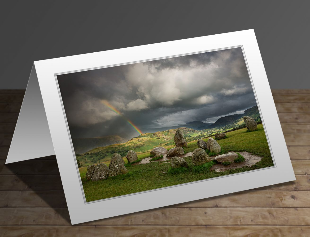 A greetings card containing the image Rainbow over the Castlerigg Stone Circle by Martin Lawrence