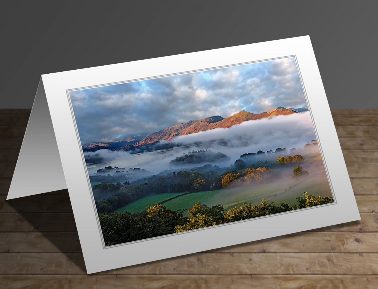 A greetings card containing the image Mists over Derwentwater and Catbells by Martin Lawrnce