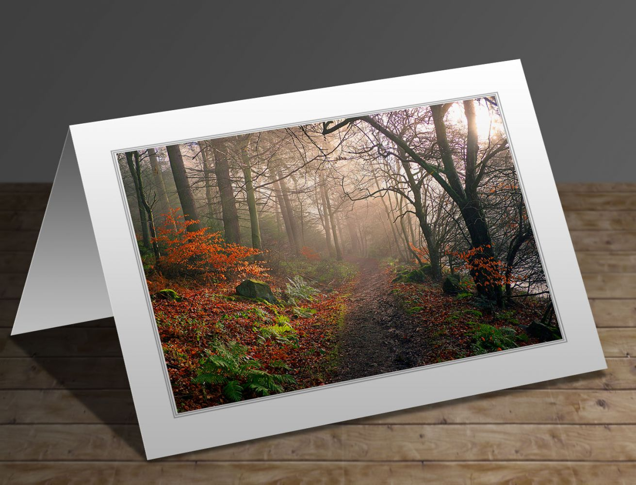 A greetings card containing the image Footpath through Dodd Wood Bassenthwaite by Martin Lawrence