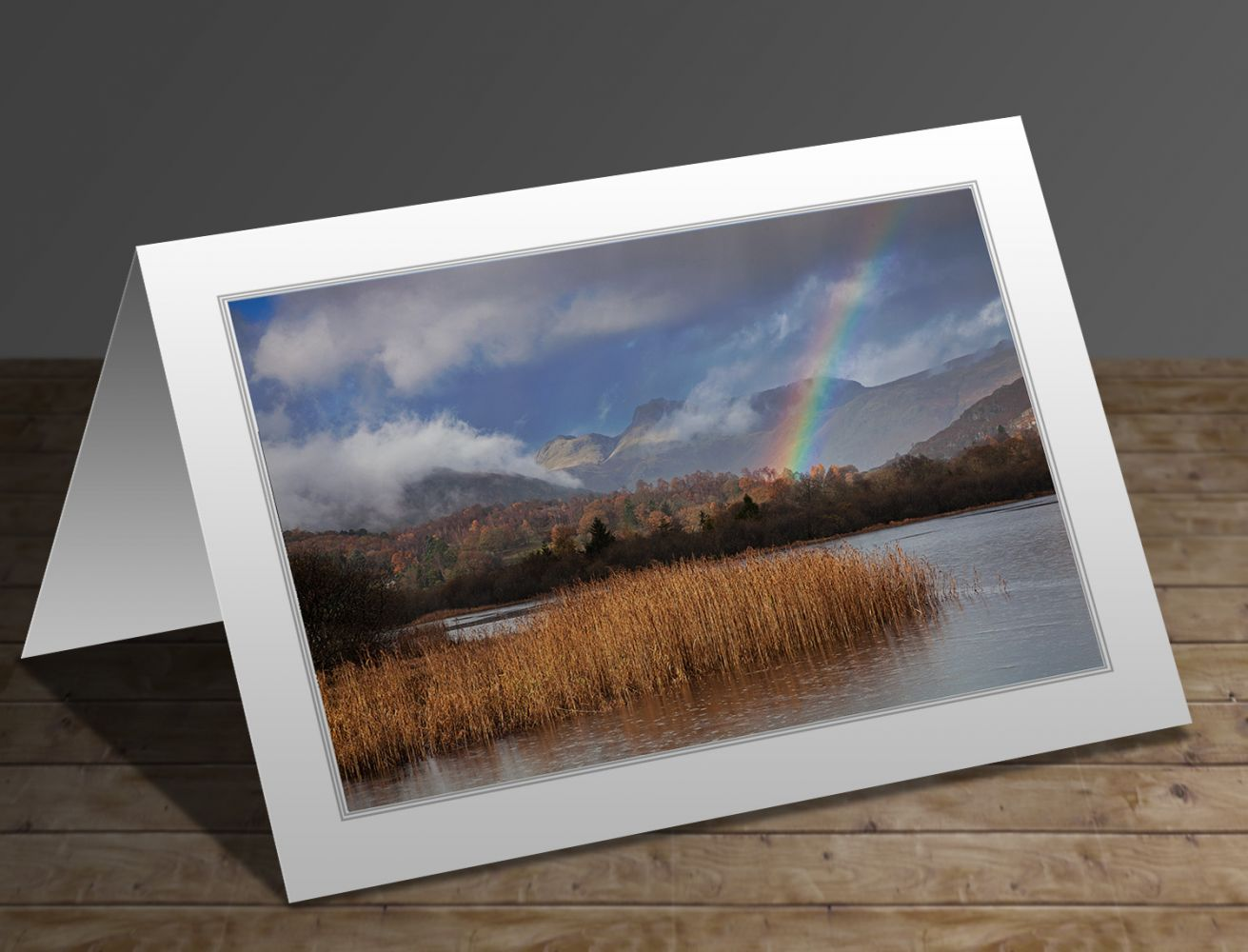 A greetings card containing the image Langdales rainbow at Elterwater Tarn by Martin Lawrence