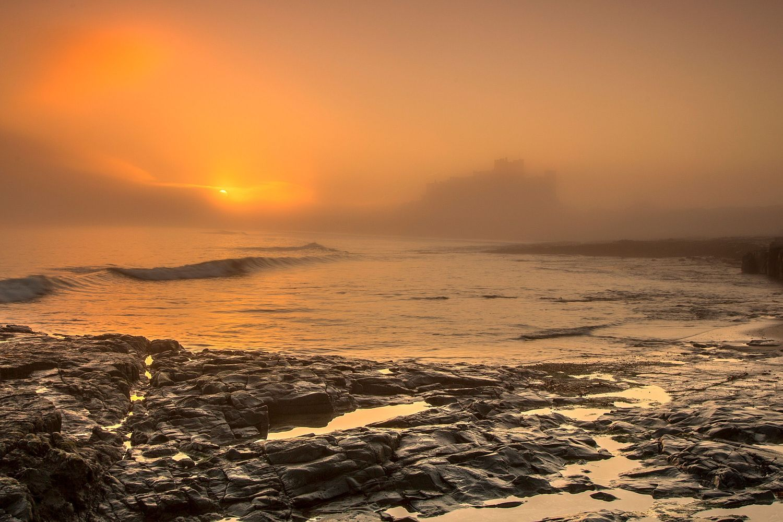 A foggy sunrise at Bamburgh Castle