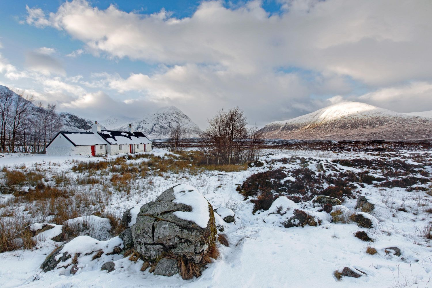 The famous Blackrock Cottage in winter at Glencoe with Buachaille Etive Mor in the background.