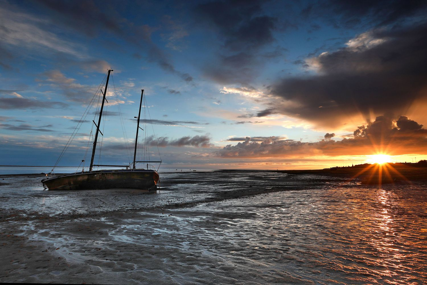 Sunset over the beached yacht at Lytham by Martin Lawrence