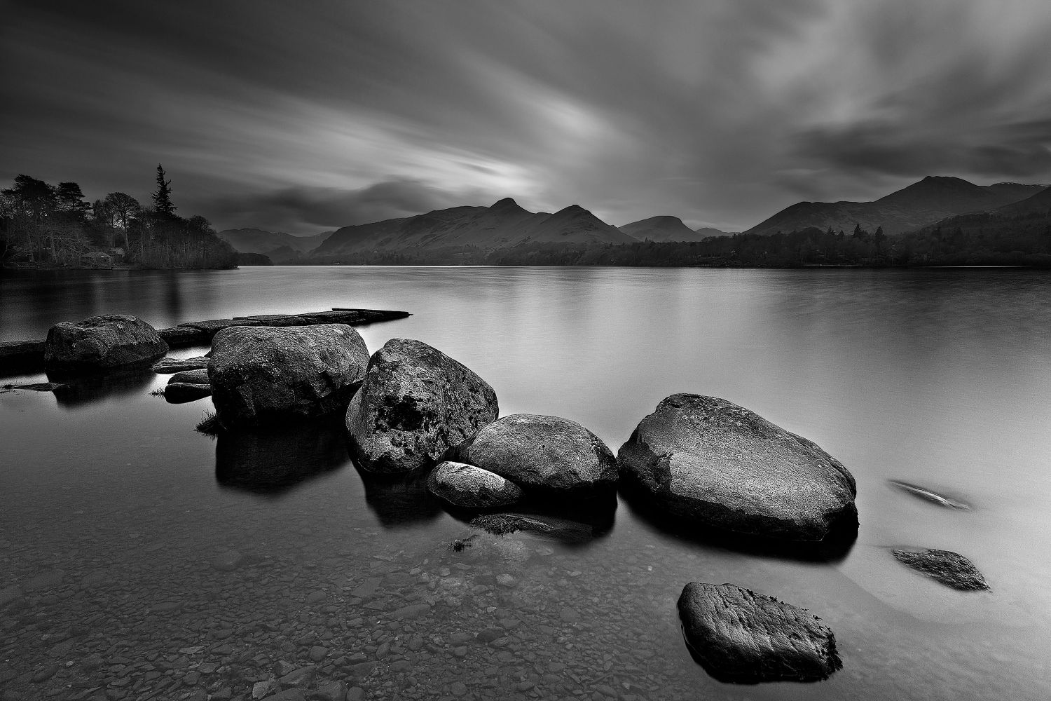 Last Rays of Light over Isthmus Bay Derwentwater in Black and White