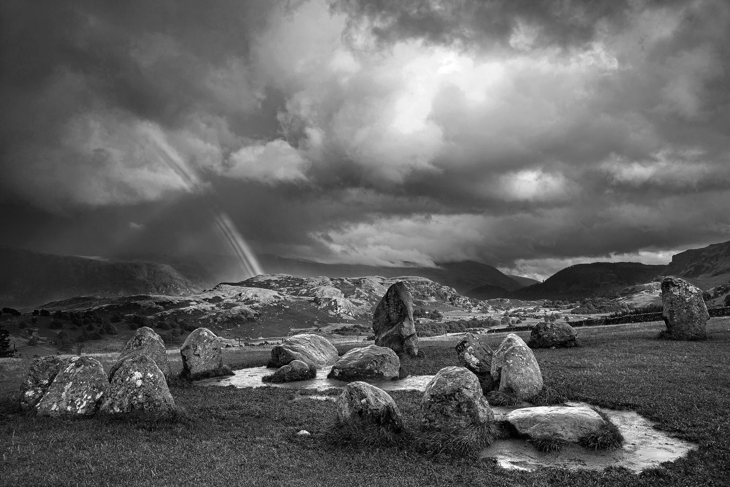 Rainbow over The Castlerigg Stone Circle in Black and White