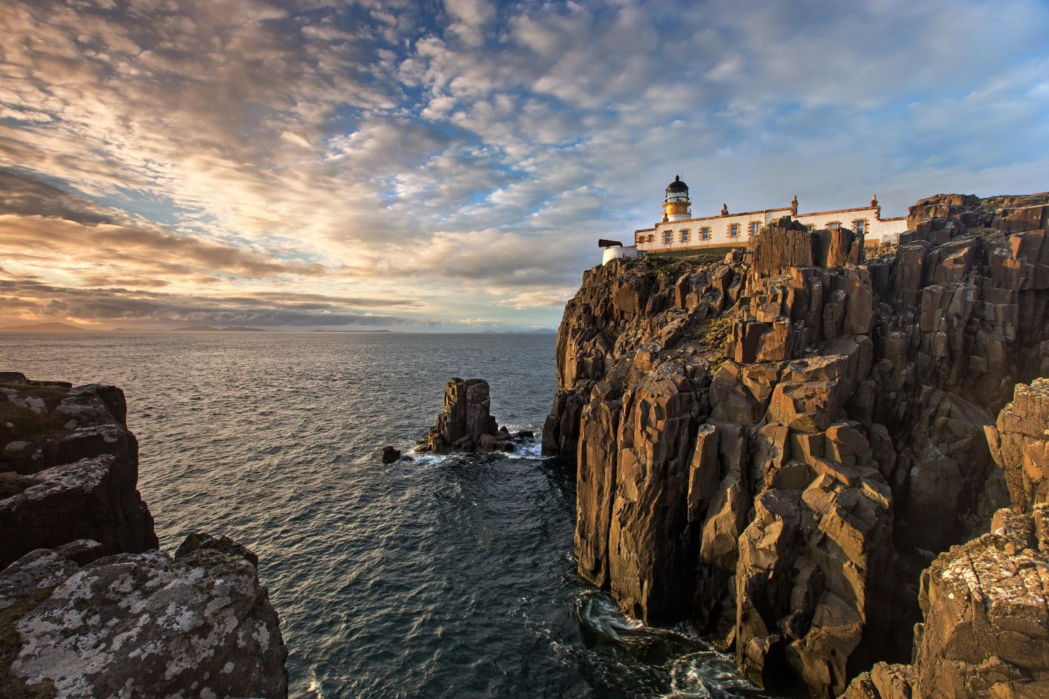 Sunset at Neist Point lighthouse on Isle of Skye's most westerly peninsula
