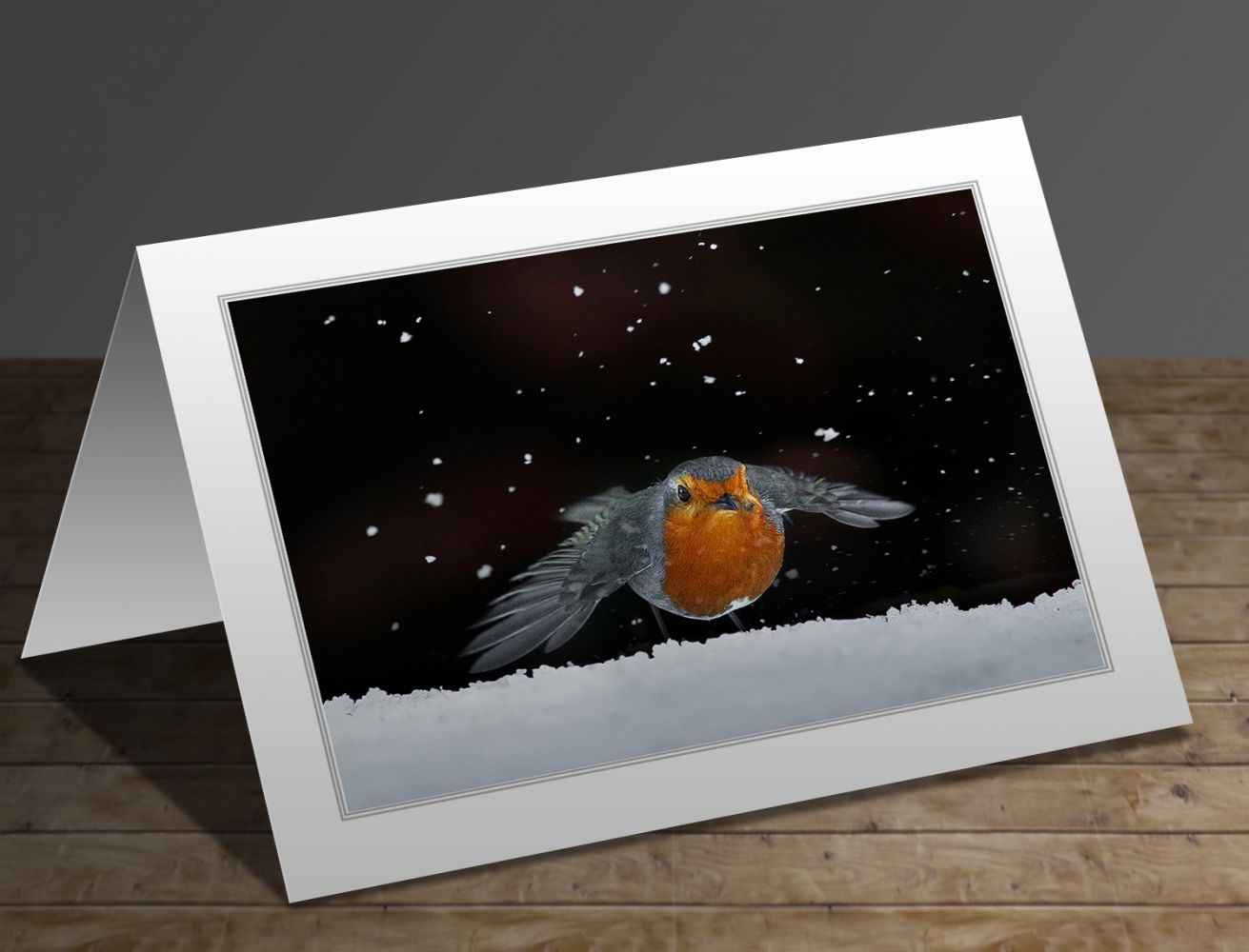 A greetings card containing the image Robin amongst the snow by Wildlife Photographer Martin Lawrence