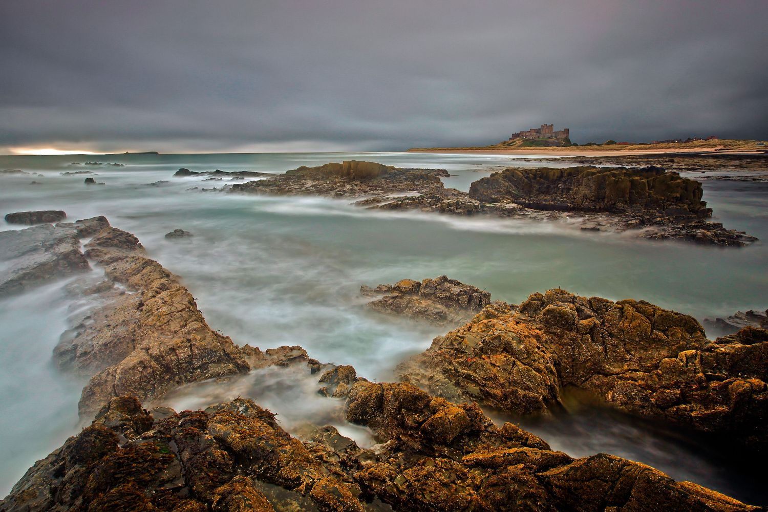 Stormy skies over Bamburgh Castle, Northumberland