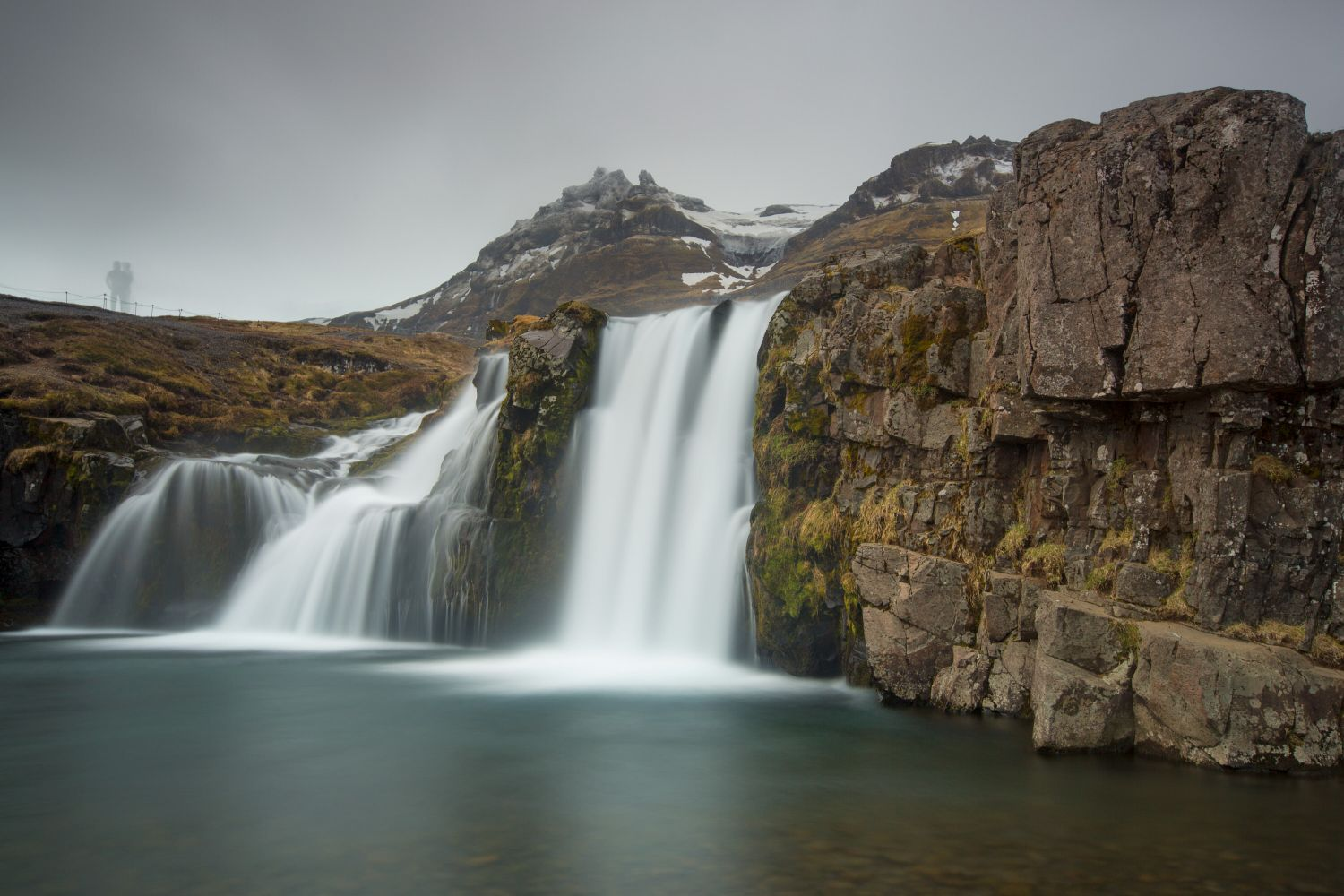 Ghosts above the waterfall Kirkjufell Iceland