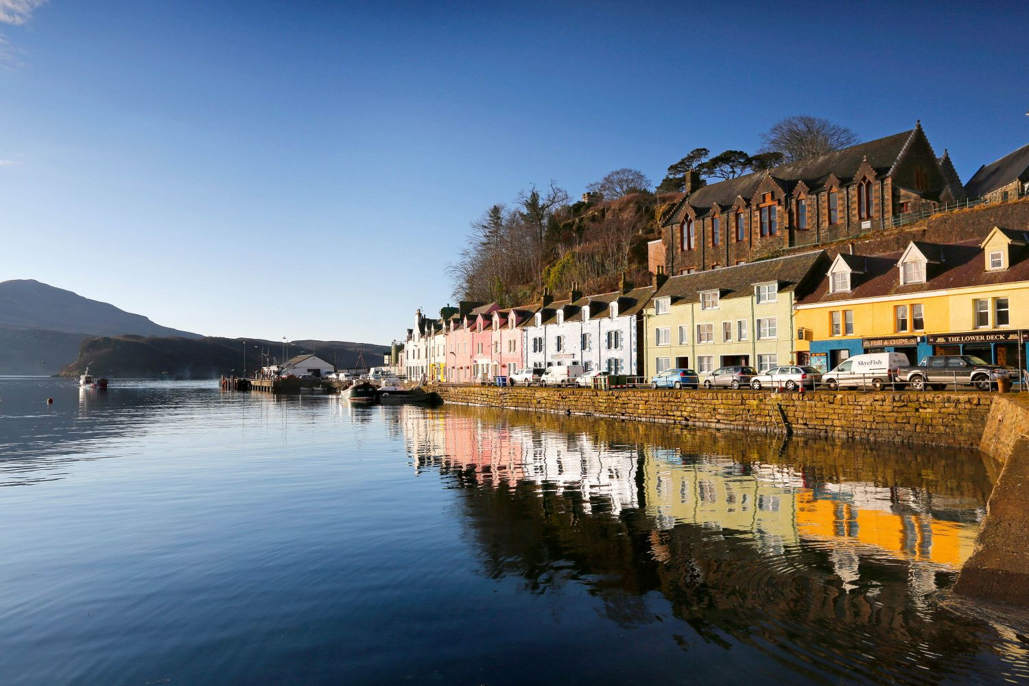 Portree Harbour surrounded by pastel coloured cottages
