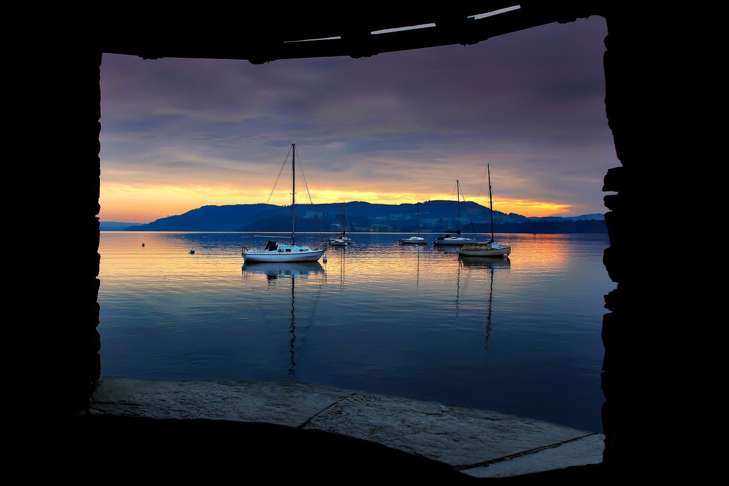 A Windermere sunset through the square window
