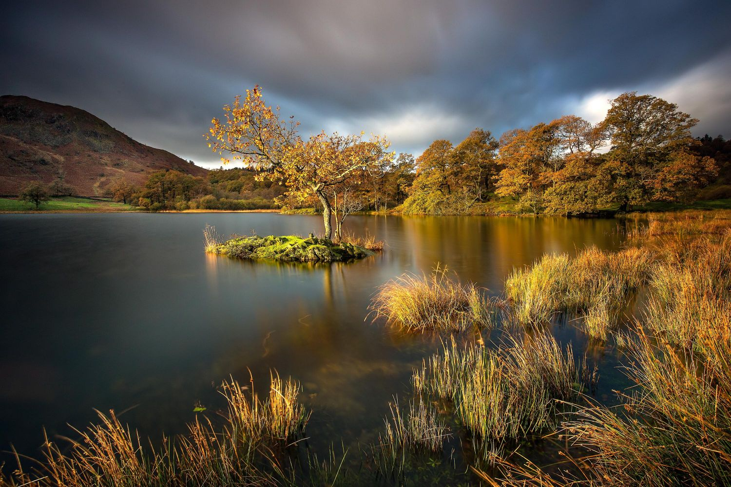 Spectacular autumn light on Rydal Water and Loughrigg Fell