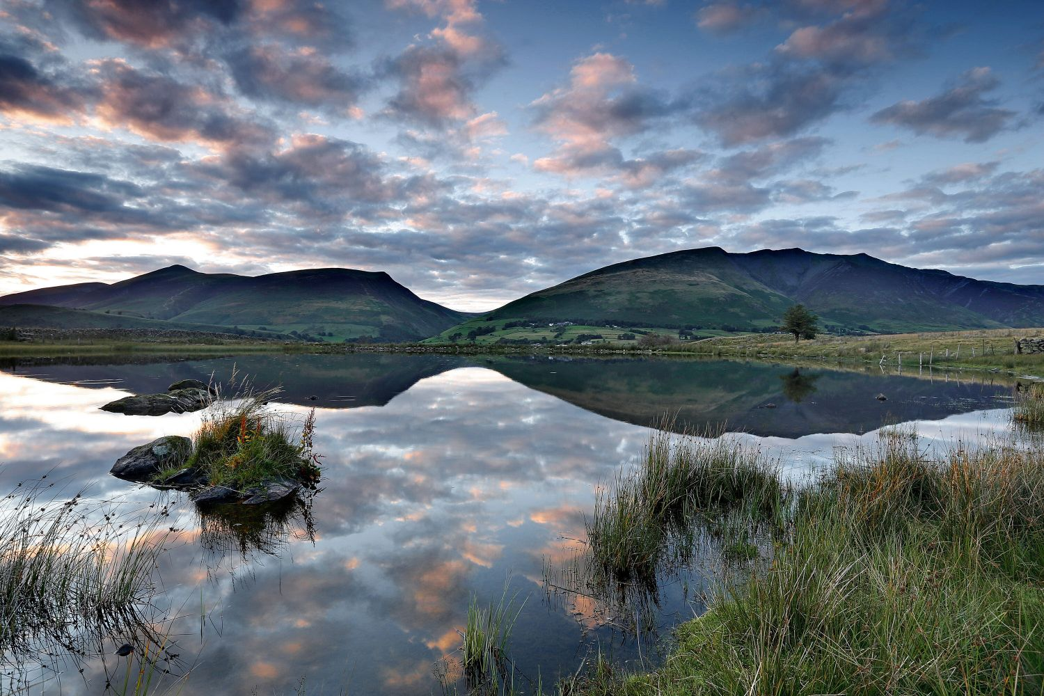 Skiddaw and Blencathra reflections in Tewet Tarn