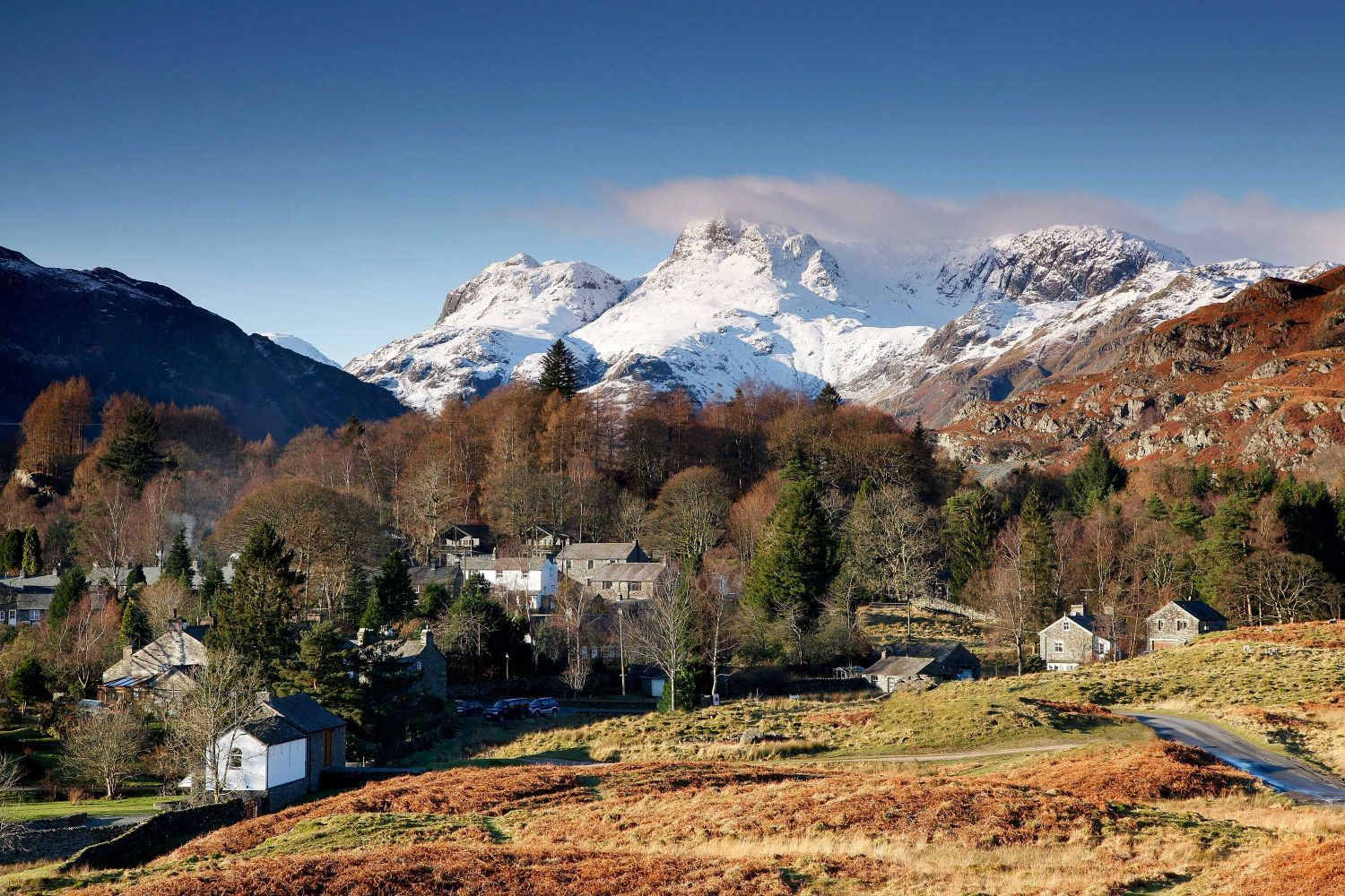 Snow on the Langdale Pikes from Elterwater Village in the English Lake District