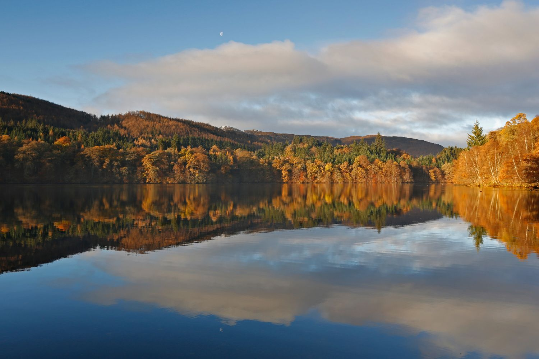 Autumn moon over Loch Faskally