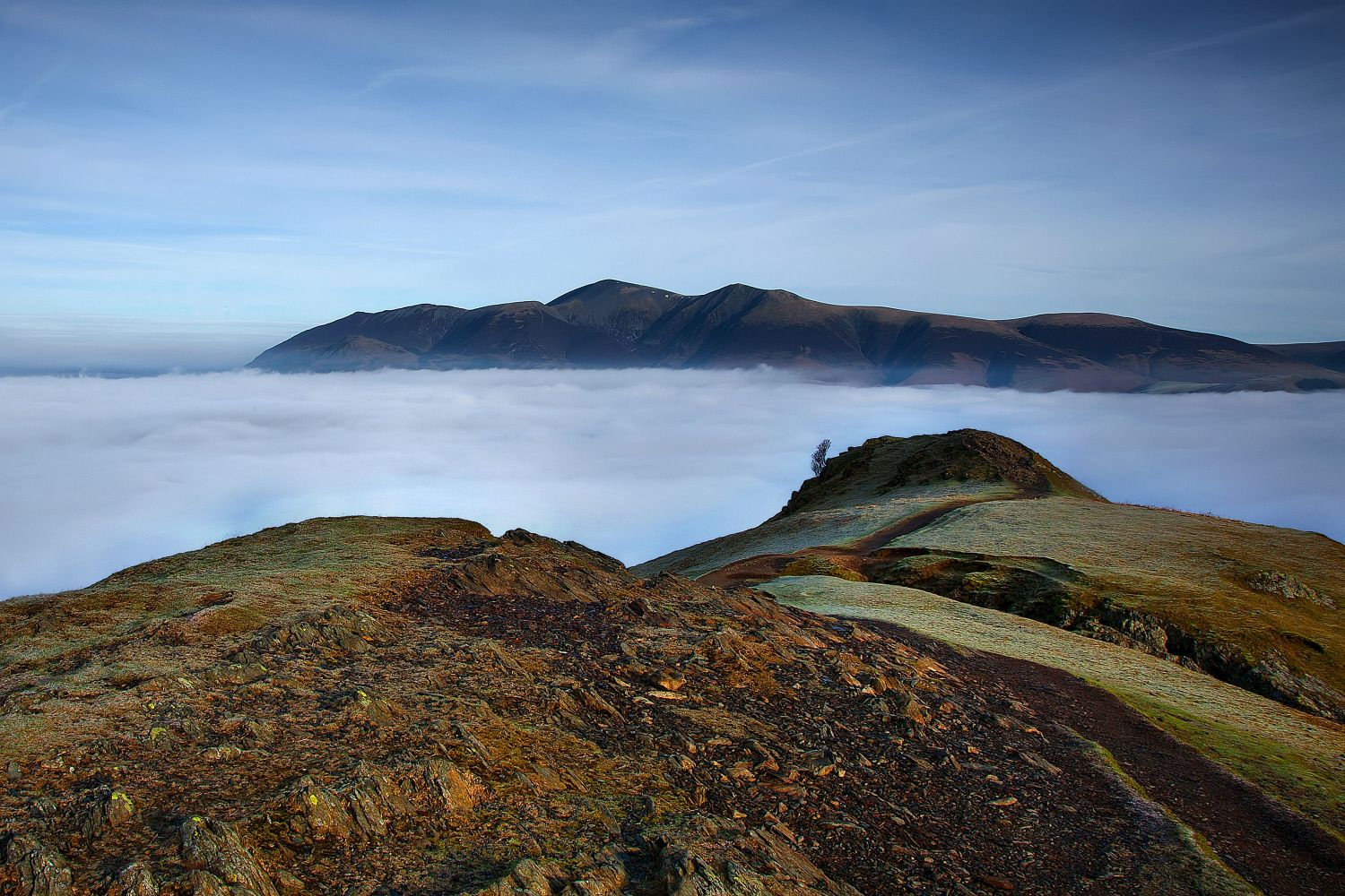 A fantastic cloud inversion showing Skiddaw appearing from out of the clouds. Taken from Catbells.