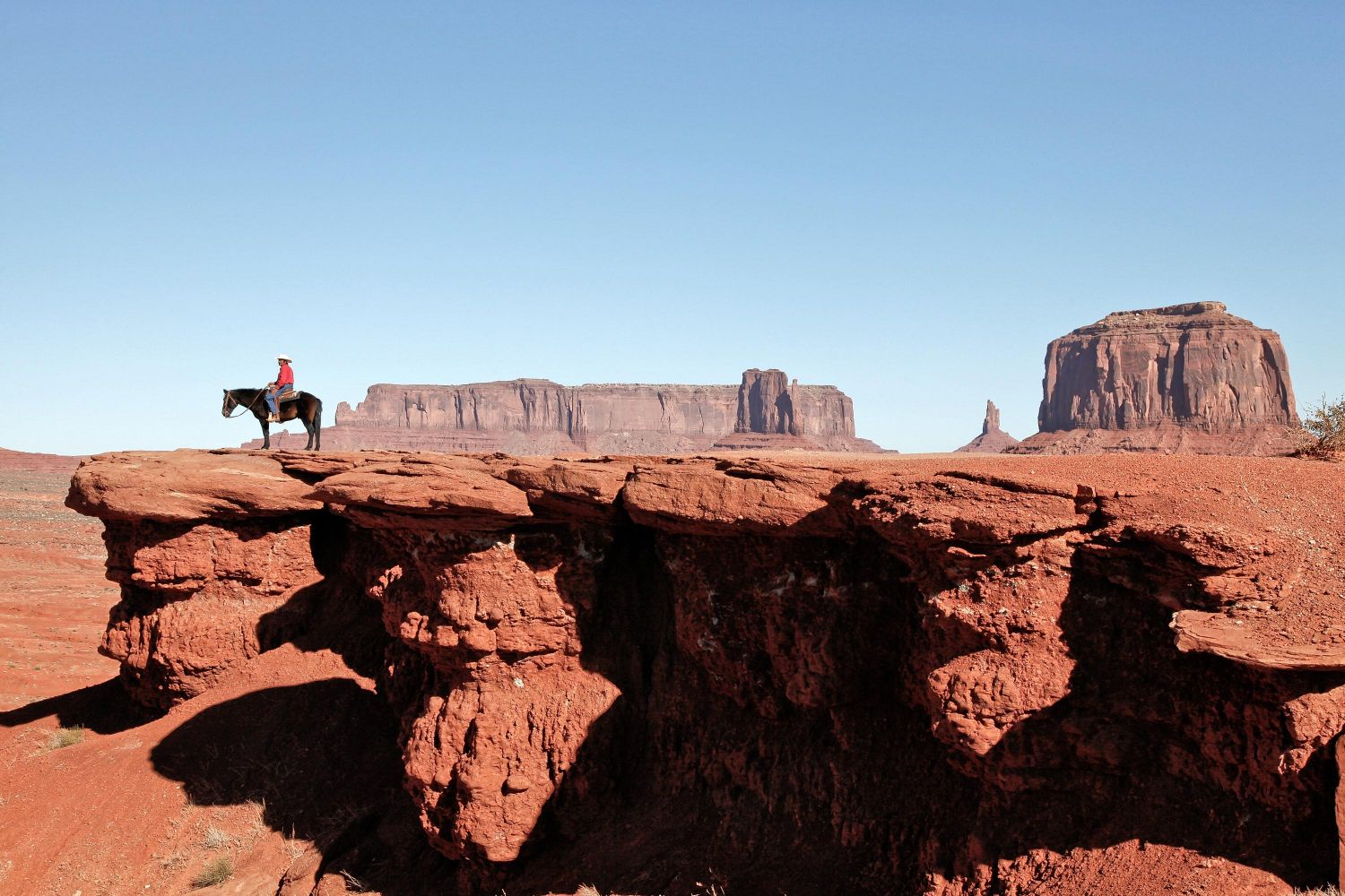 John Ford Point Overlook, Monument Valley - a Navajo Indian on Horseback