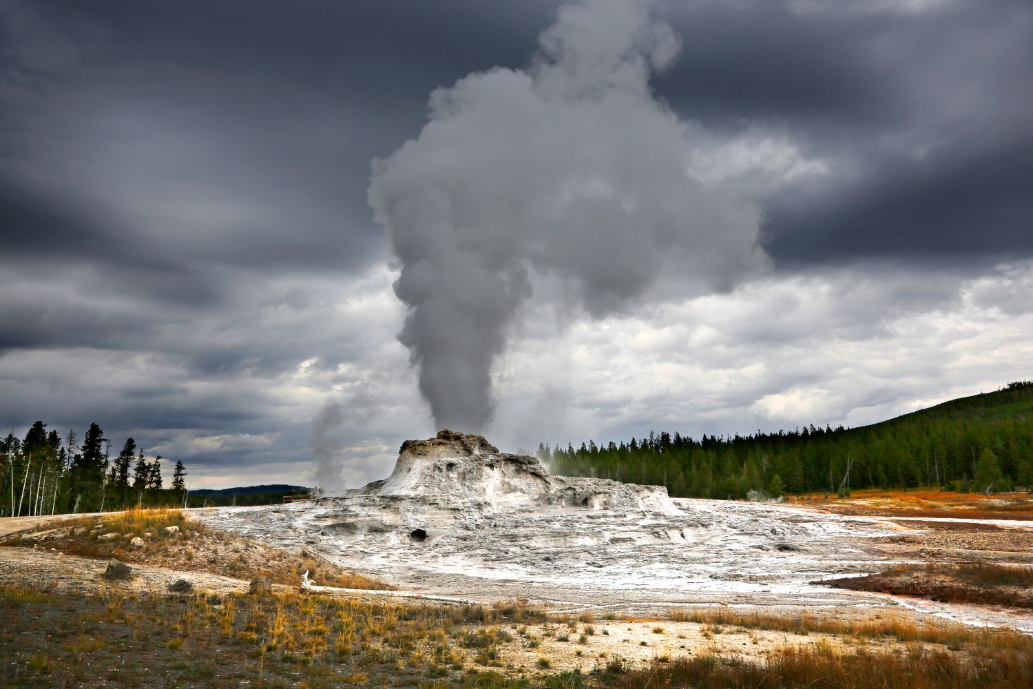 Castle Geyser Yellowstone erupting shortly before an impending storm