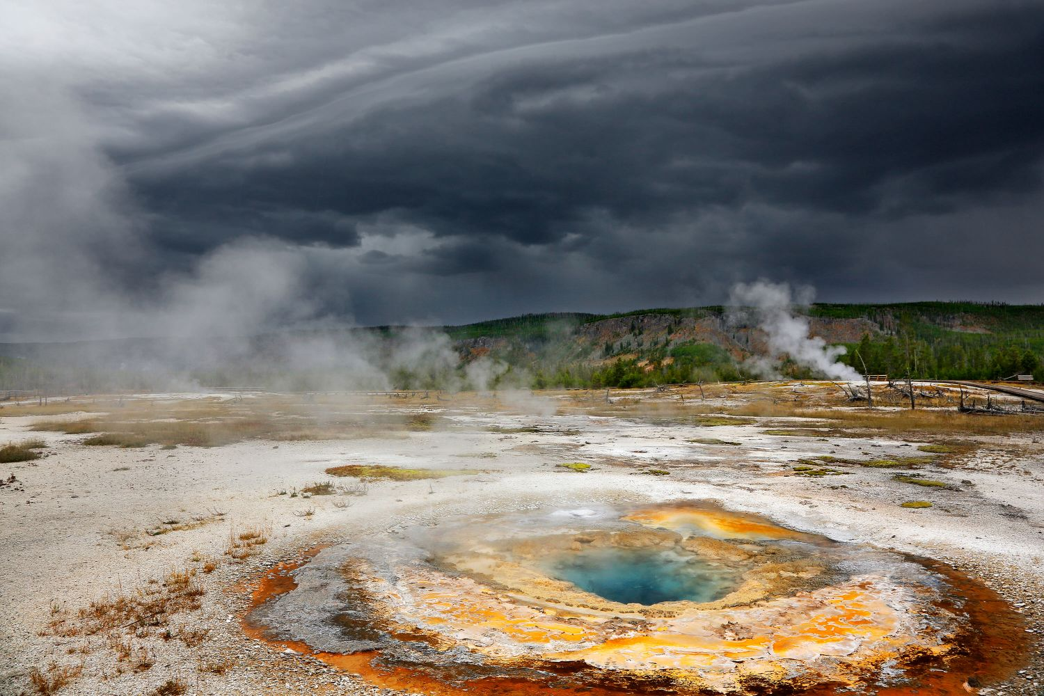 Storm clouds above Mustard Springs at Yellowstone National Park