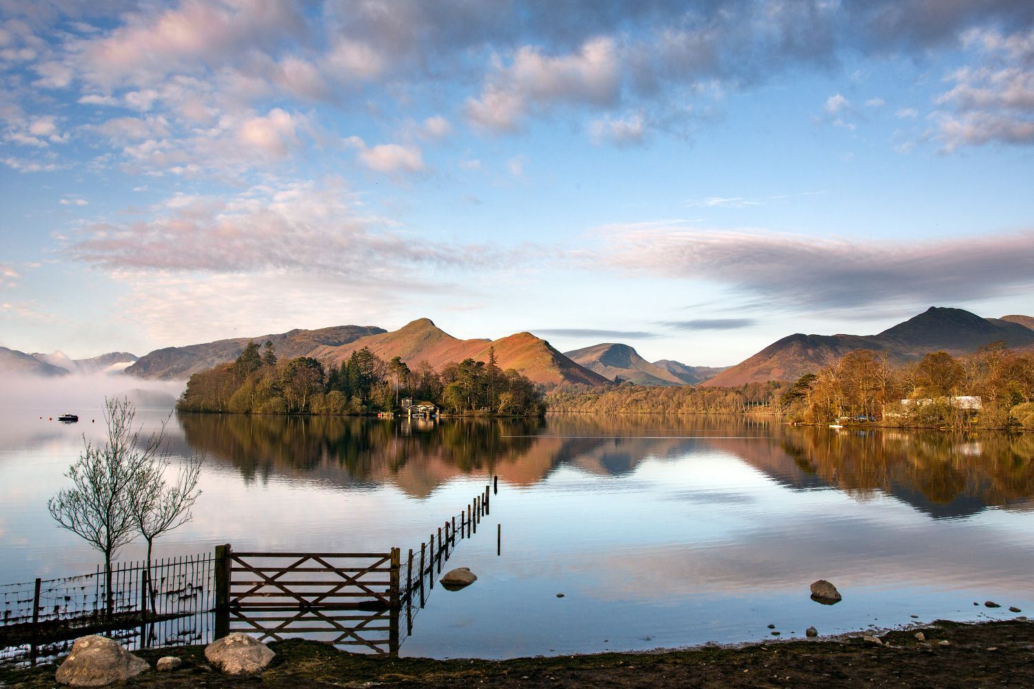 Derwentwater sunrise with Catbells and Causey Pike beautifully reflected in the lake
