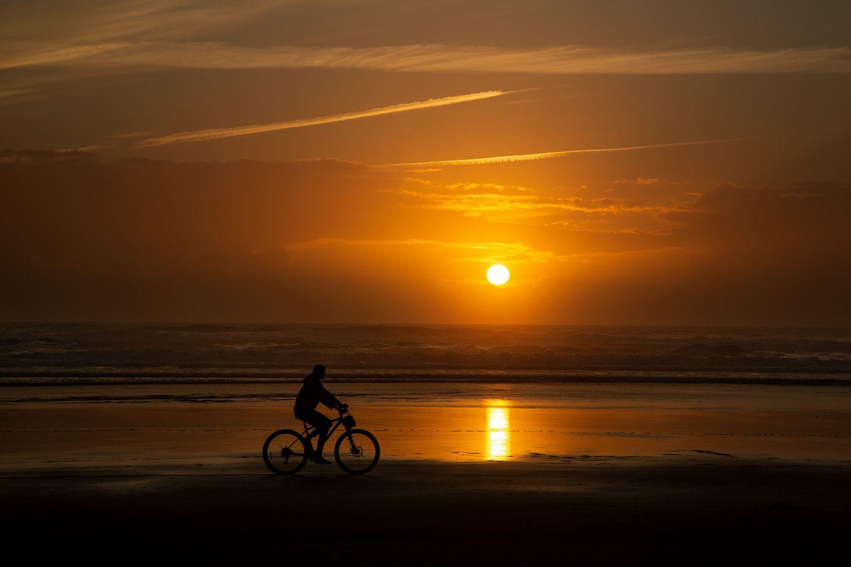 Cyclist silhouette on Cannon Beach Oregon