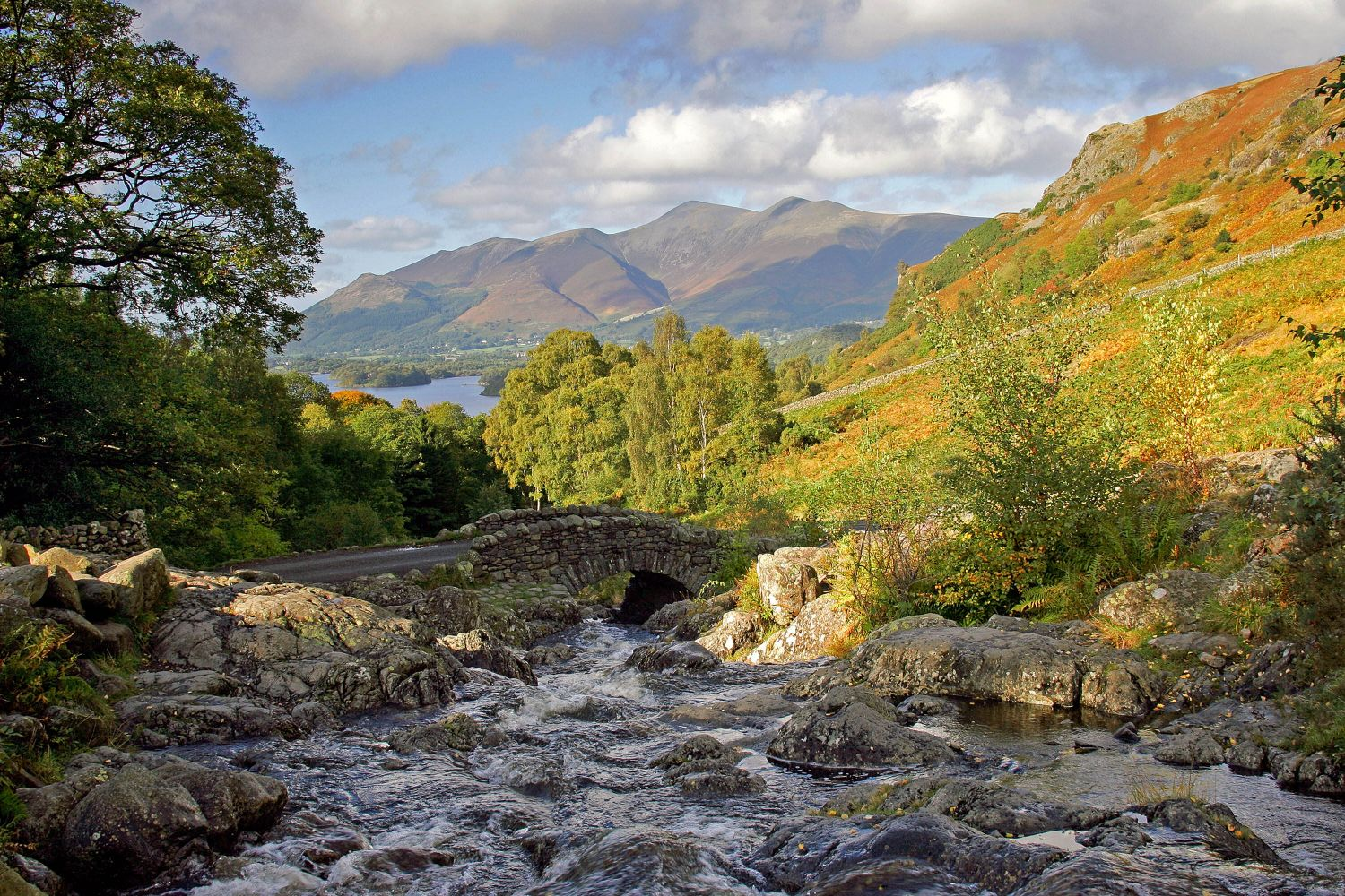 Autumn sunshine at Ashness Bridge, Derwentwater an iconic packhorse bridge in the English Lake District