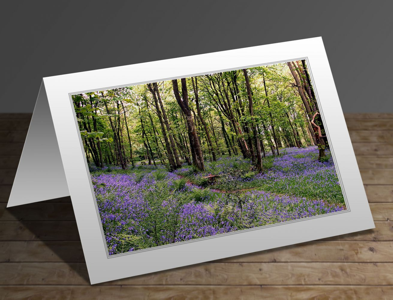 A greeting card featuring the image A carpet of bluebells at Calder Vale, Lancashire by Martin Lawrence