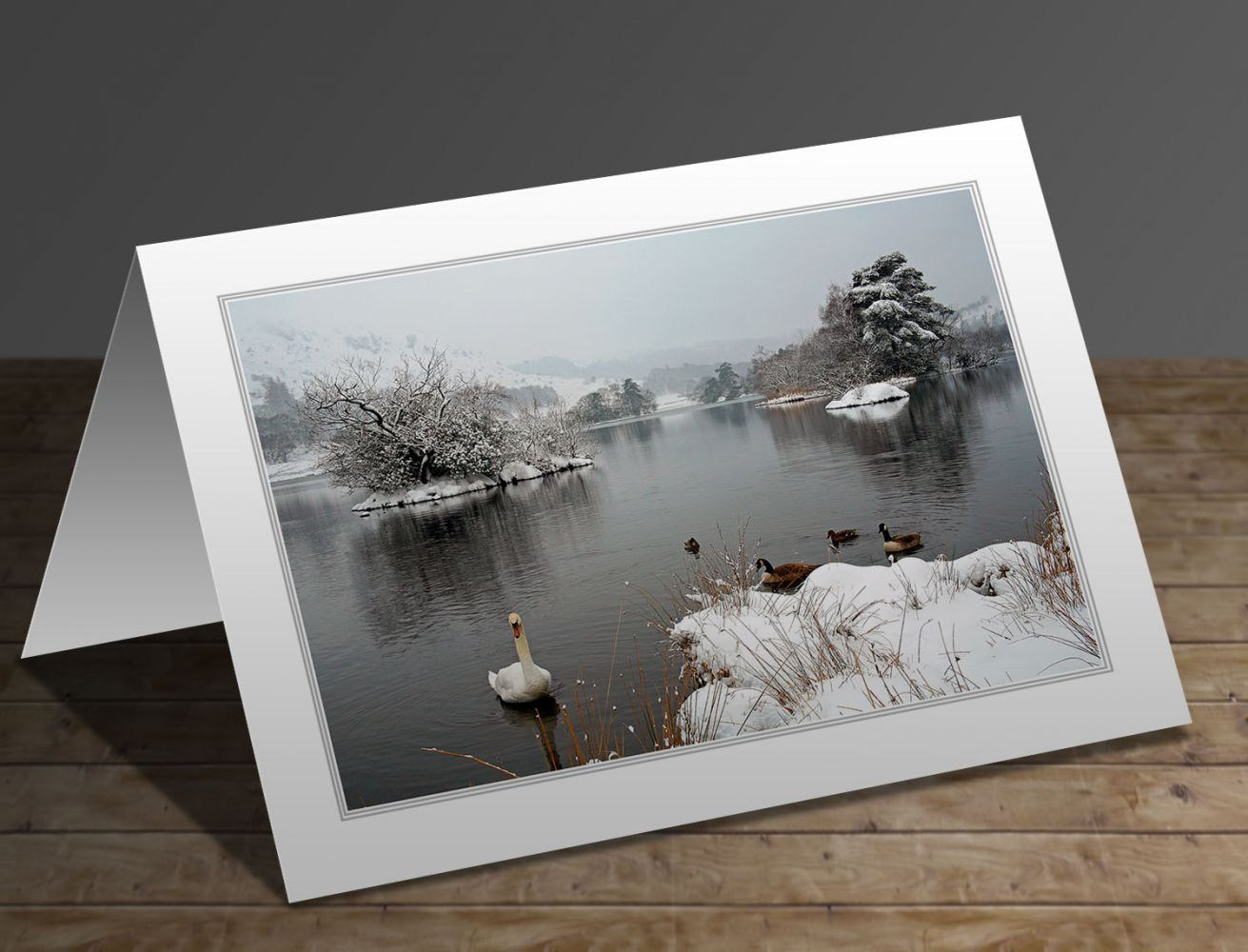 A greeting card containing the image Swan Lake at Rydal Water in the English Lake District by Martin Lawrence