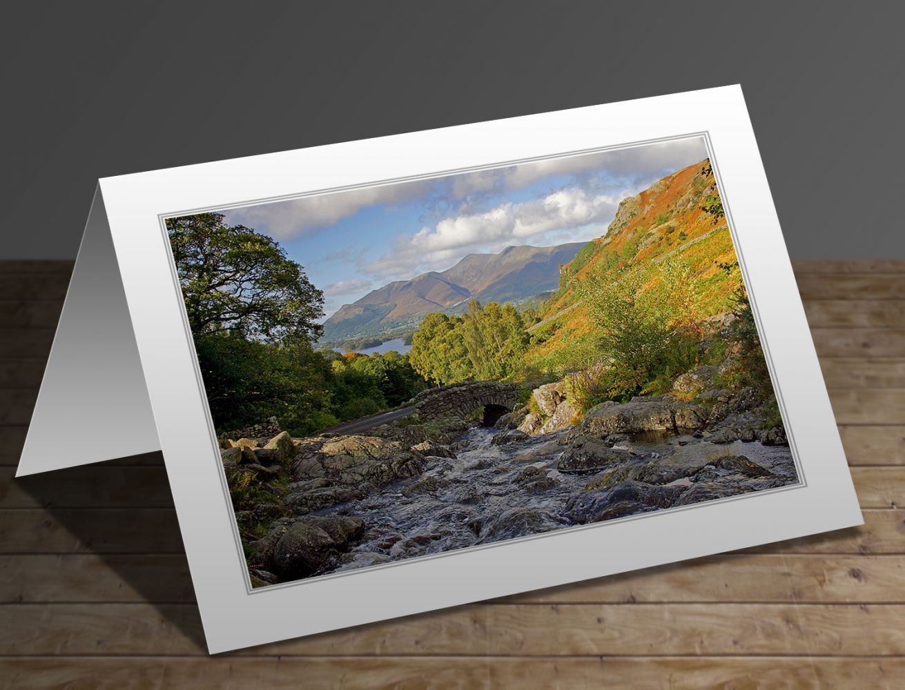 A greeting card containing the image Autumn sunshine at Ashness Bridge in the English Lake District by Martin Lawrence