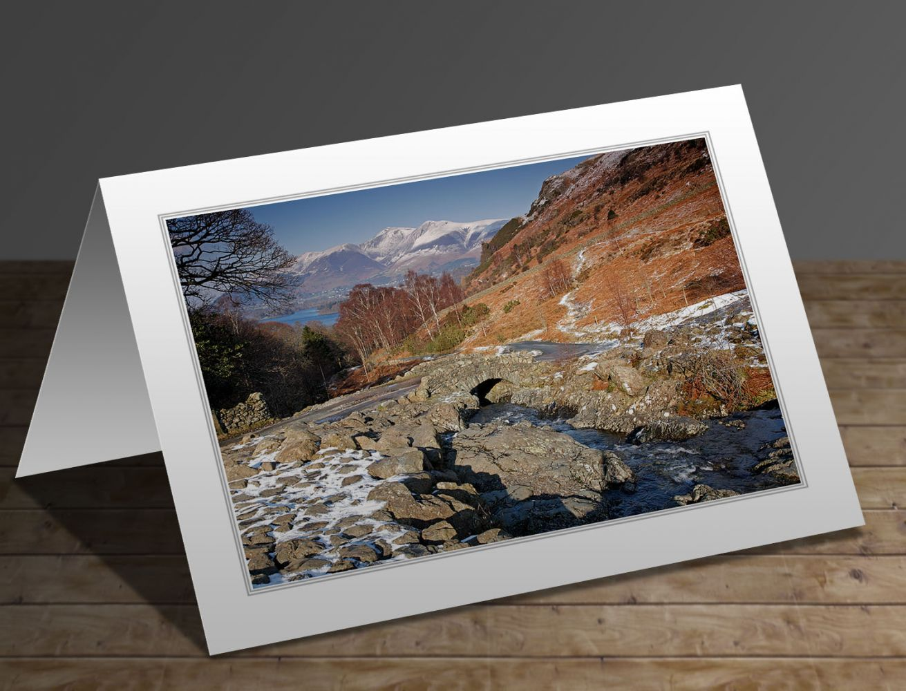 A greeting card containing the image Melting snow at Ashness Bridge in the English Lake District by Martin Lawrence