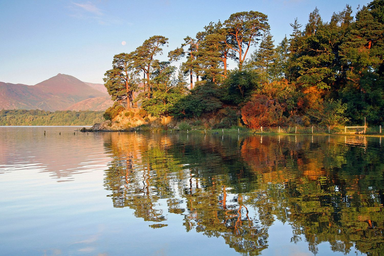 Autumn sunshine at Friars Crag with the trees reflecting beautifully in the lake.