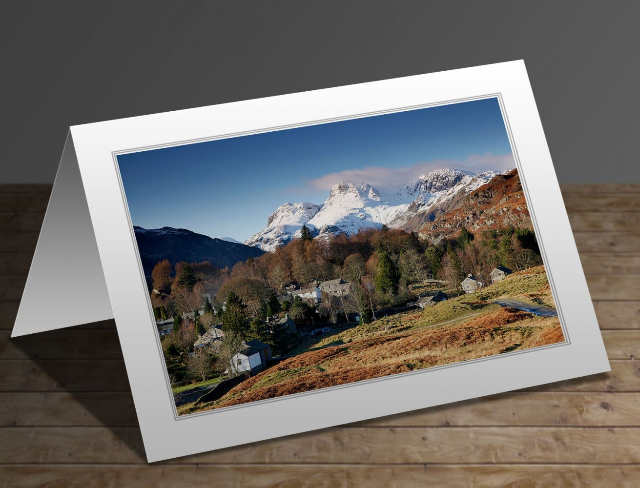 A greeting card containing the image Snow on the Langdale Pikes from Elterwater village in the English Lake District by Martin Lawrence