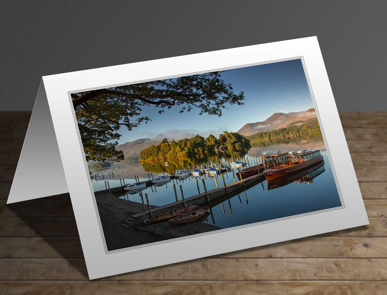 A greeting card containing the image Keswick Boat Landings on a still summer morning in the English Lake District by Martin Lawrence