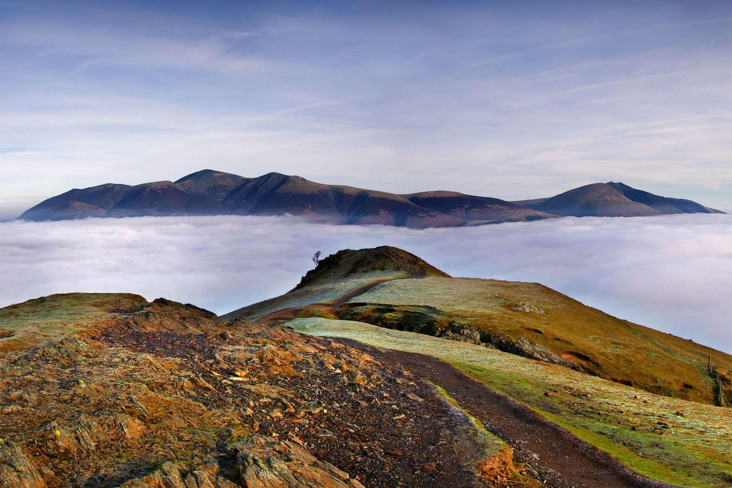 Above the clouds on Catbells with Skiddaw and Blencathra visible beyond