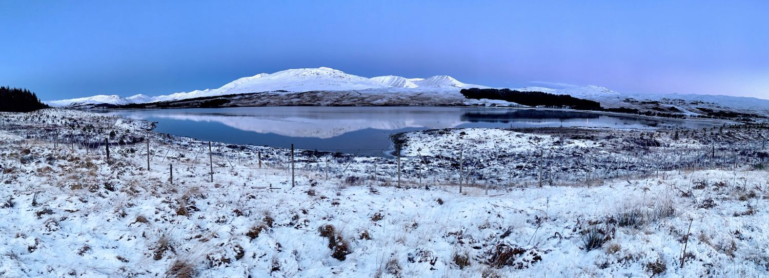 Loch Tulla on Rannoch Moor before sunrise with the Black Mount in the distance
