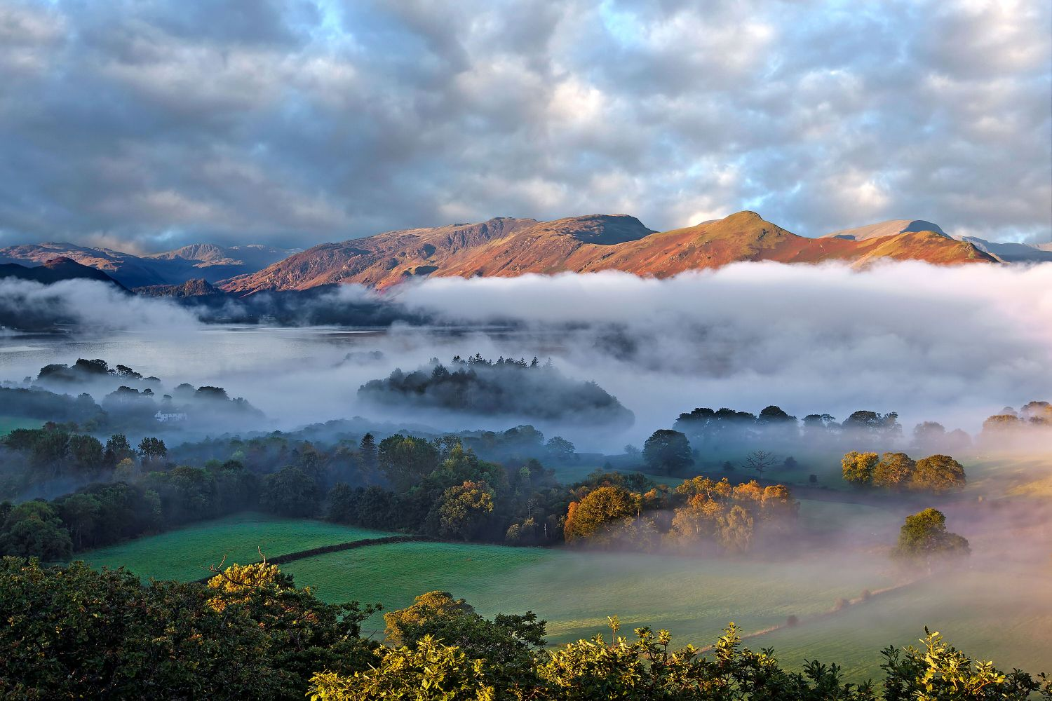 Mists over Derwentwater and Catbells from Castlehead