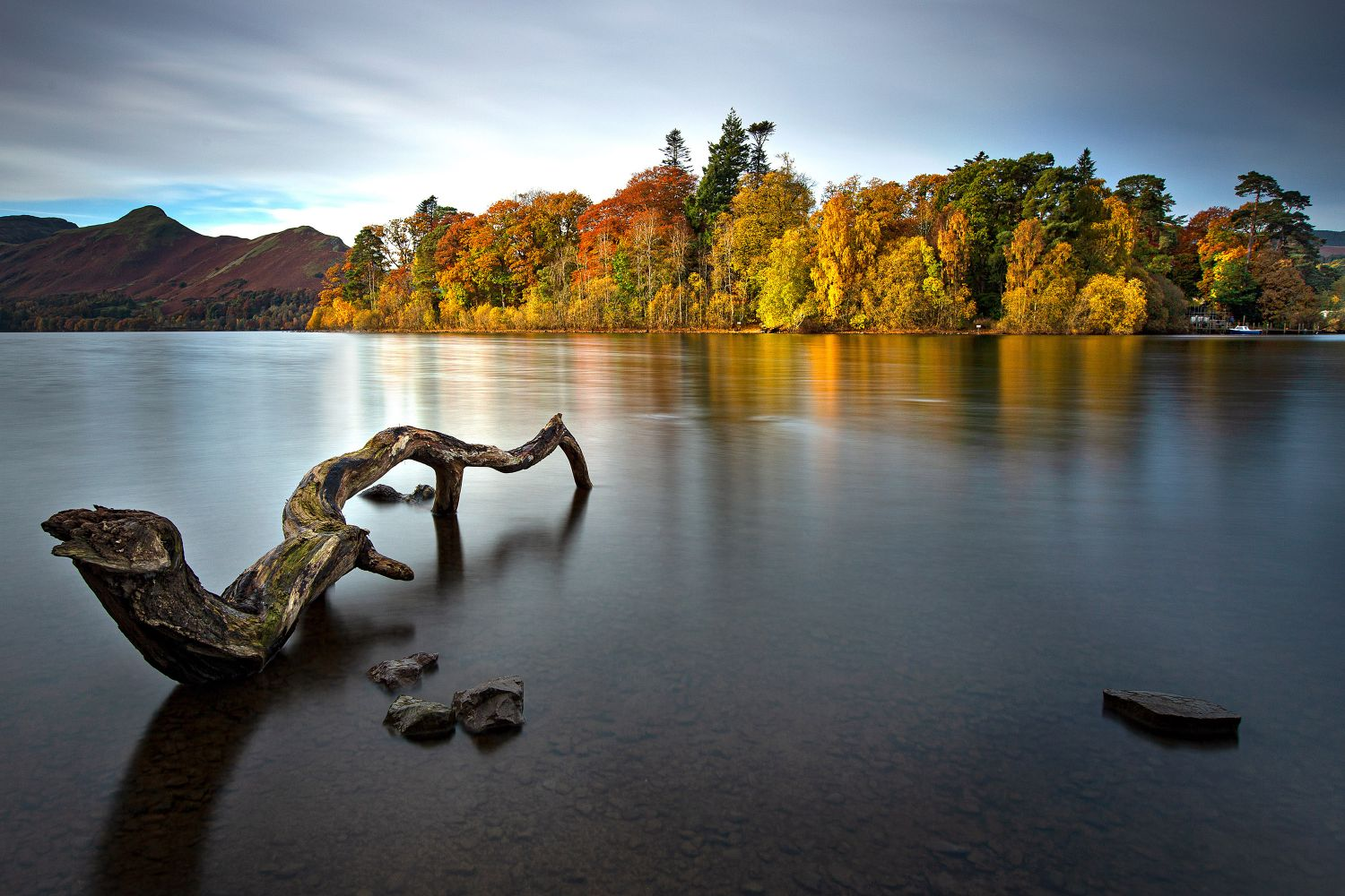 A long exposure image showing the Shades of autumn on Derwent Isle